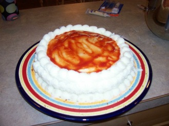 "This was a birthday cake for my husband who isn't a ""sweets guy"" it's a vegitarian meat loaf cake with mash potato ""frosting"" and ketchup sauce"