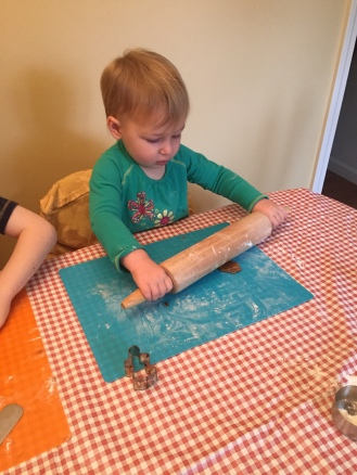 My daughter rolling gingerbread dough