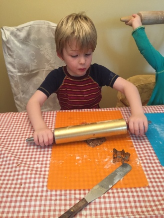 My son rolling the gingerbread dough